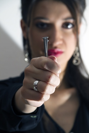Woman holding nails