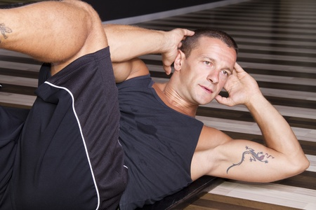 Fitness instructor doing sit-ups   Stock Photo