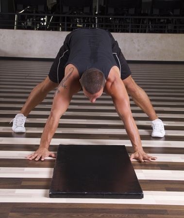 Fitness instructor doing stand on his head