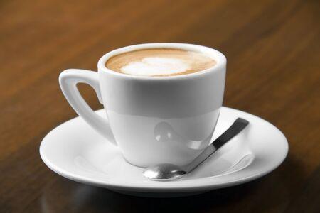 Macchiato espresso coffee in white cup with nice spoon
