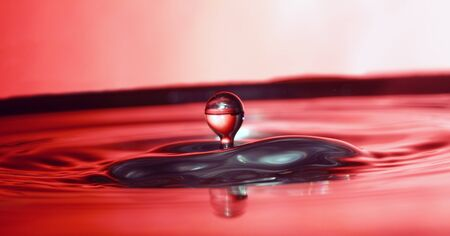 Abstract red water drop. Macro close up studio shot