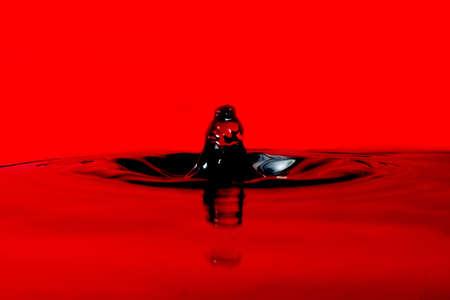 Red abstract water drop. Macro close up shot