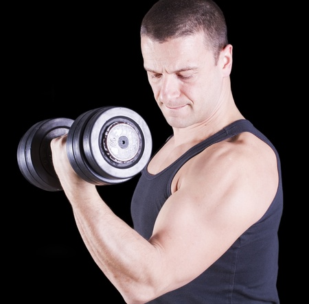Instructor weightlifting in the gym Stock Photo