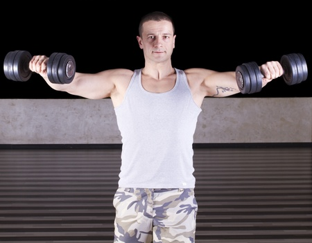 Muscular men exercising with weights