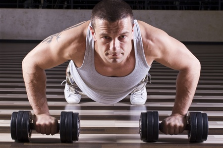 Pushups workout while leaning on weights photo
