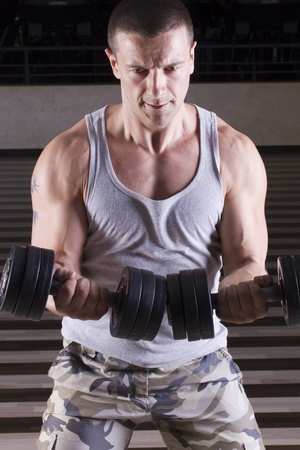Strong man weightlifting in the gym Stock Photo
