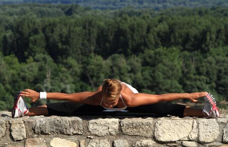 Stretching legs on an ancient wall  Beautiful background Stock Photo