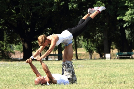 Male and female fitness instructors practising in nature