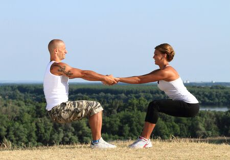 Couple doing fitness in nature Stock Photo