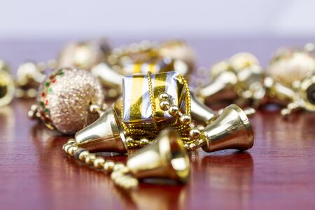 Christmas presents with bells and balls and pearls all over Stock Photo