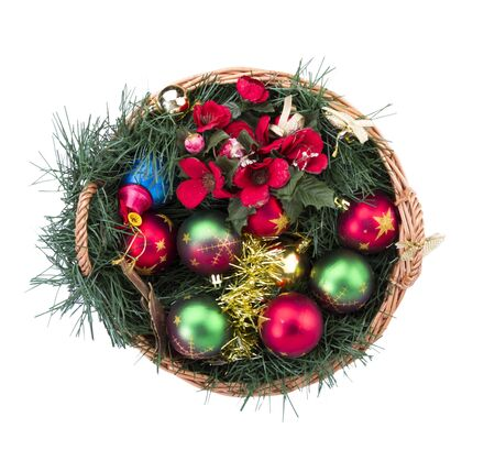 Christmas basket filled with decorative balls, bells, flowers... Stock Photo