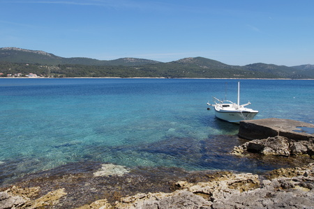 Boat on the Trestenik islet, Adriatic sea, Dalmatia Stock Photo