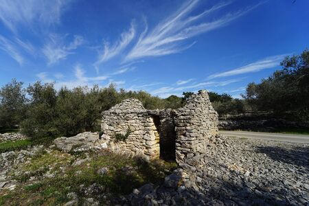 A ruined stone house in the countryside Stock Photo