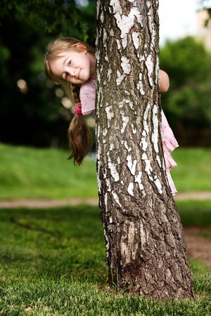 tree vertical: Little girl in outdoor settings
