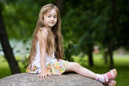 Little girl in outdoor settings photo