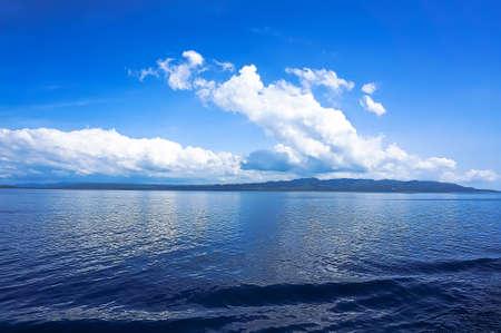 blue sea blue sky horizon with white Cumulus clouds 写真素材