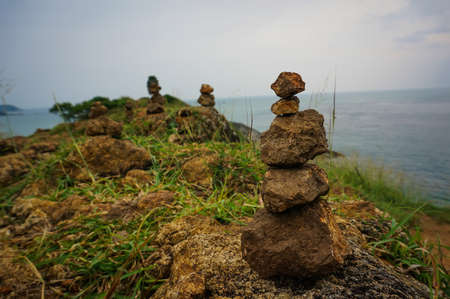 eastern philosophy: stone rests on stone pyramid on the island