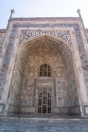 Arch the Taj Mahal and texture of the building Agra, India. Taj Mahal is widely recognized as the jewel of Muslim art and one of the universally masterpieces of the world