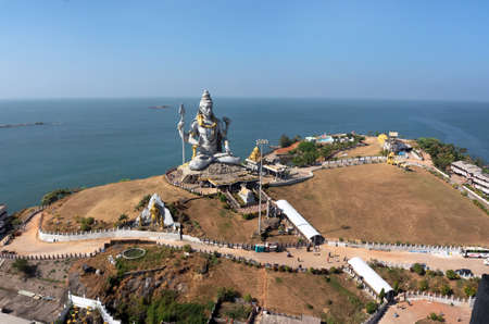 karnataka: MURUDESHWAR, INDIA Statue of Lord Shiva was built at Murudeshwar temple on the top of hillock which overlooks the Arabian Sea and it is 37 meters in height.