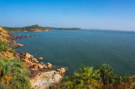 karnataka: the scenery is beautiful rocky coast, blue sea and cloudless sky in Om beach, Gokarna, Karnataka, India