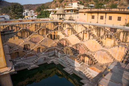 baori: Old ancient Indian deep well with lots of steps near the amber fort, Jaipur Stock Photo