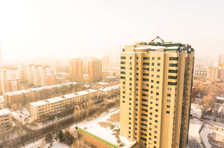 High building in Astana at the background of the city early in the morning. Kazakhstan Real Estate.