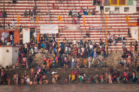 benares: Crowds of people the stairs of the embankment of the river Ganges, Varanasi, India.