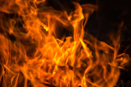 gas fireplace: perfect fire background. blaze fire flame texture background. a fire in the dark Stock Photo