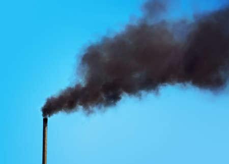 fuming: Black pipe with black smoke. Factory chimney smoking, heavy black smoke on the sky. ecology problems Stock Photo