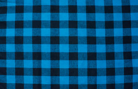 Blue Checked Fabric Tablecloth. Blue Black Cloth In A Cage In The  Background Stock