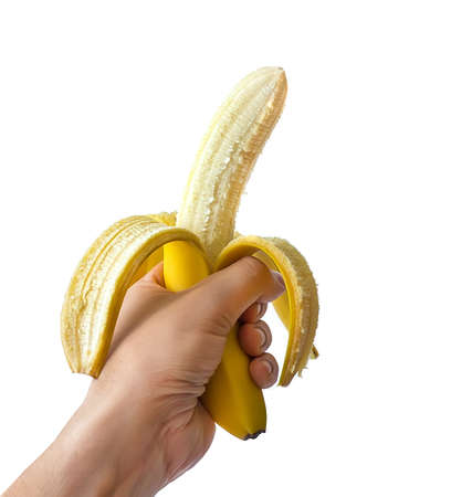 healthful: Bright yellow ripe banana in the hand of man, banana with open peel isolated on white Stock Photo