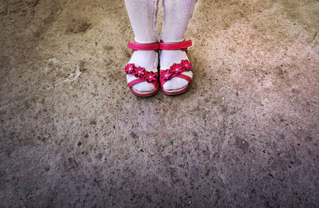 Girls feet with sandals and white stocking. Stock Photo
