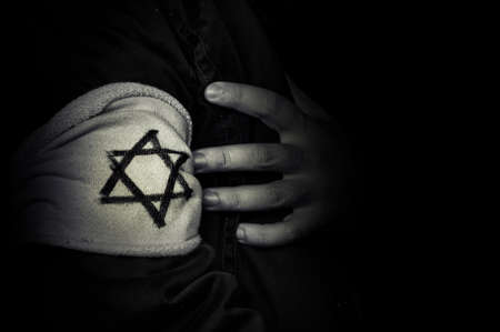 hand with the badge of the star of David.