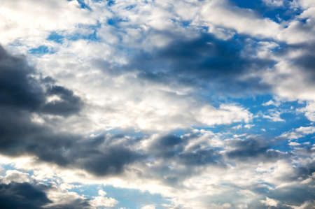 grey clouds and white clouds on bright blue sky. Ominous sky. The soft cloud is on the blue sky