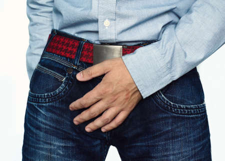 Close up of a man with hands holding his crotch, isolated on a white background