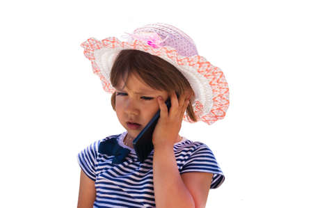 Cute little girl speaking on the cell phone. isolated on a white background Stock Photo