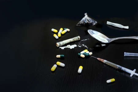Hard drugs on dark table. The concept of addiction. view with copy space Stock Photo