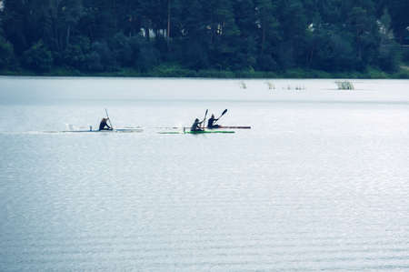 Kayaking competitions on the lake. competitions on rowing on open water Stock Photo