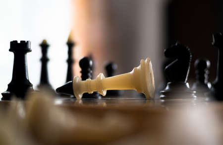 The chess pieces are placed on the chessboard. Defeated white king. The player admitted defeat