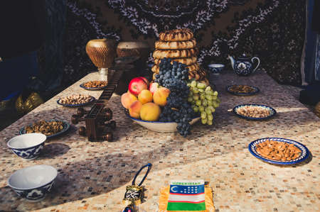 sephardic: The traditional food in Central Asia with treats, food and old national musical instruments. Inside the Yurt. The middle East. Oriental flavor Stock Photo