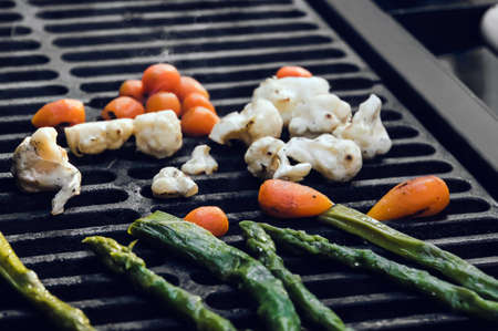 Grilled vegetables - green beans, cauliflower peppers and carrot. Selective focus.