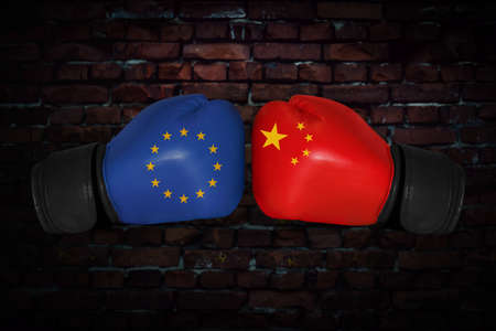 A boxing match. Confrontation between the European Union and China. chinese and EU, EC national flags on Boxing gloves. Sports competition between the two countries. Concept foreign policy conflict.