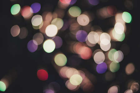 Photo of bokeh lights on black background. Christmas and new year background of fireworks.