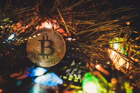 bitcoin and new year. Crypto currency bitcoin on a Christmas background. problems and business growth. New Years warm tinting.