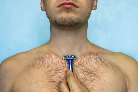 Man shaving his chest with razor, closeup of body. Stok Fotoğraf
