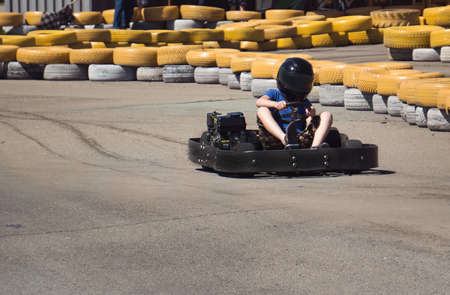 Children kart at high speed. card rides on the kart track Stock Photo