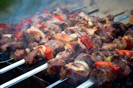 Grilled skewers with vegetables and meat. Roasted meat on the grill.