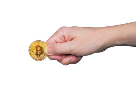 Mans hand holds a gold coin bitcoin coin. Isolated on white