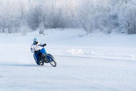 motorcycle on studded tires. Extreme bike race in winter. motorcycle on the ice of the frozen Lake Baikal. Racer on ice. Motorcycle with studded tires driving on the frozen lake. Winter extreme sports