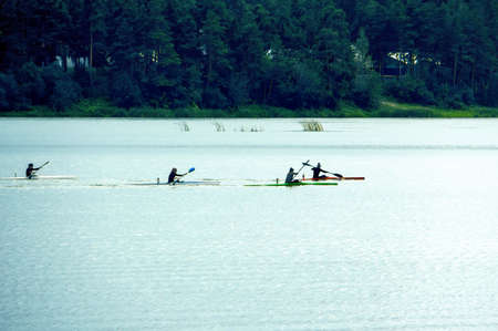 Women compete in rowing on kayaks. The competitions among women on the lake Stock Photo